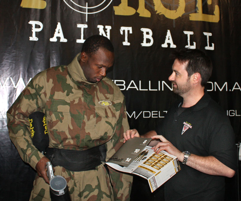 Usain Bolt looking over an IPG ticket at Delta Force Dingley Melbourne